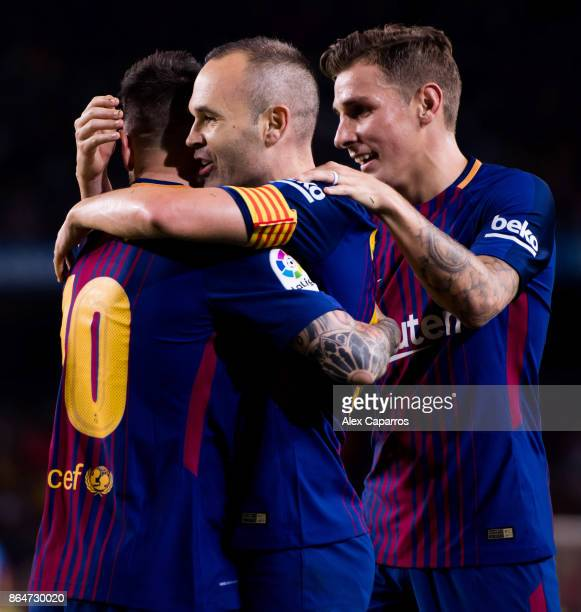 Andres Iniesta of FC Barcelona celebrates with his teammates Lionel Messi and Lucas Digne after scoring his team's second goal during the La Liga...