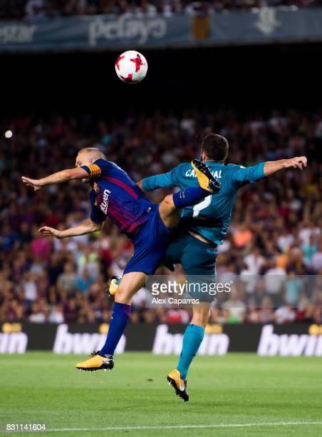 Andres Iniesta of FC Barcelona competes for the ball with Daniel Carvajal of Real Madrid CF during the Supercopa de Espana Supercopa Final 1st Leg...