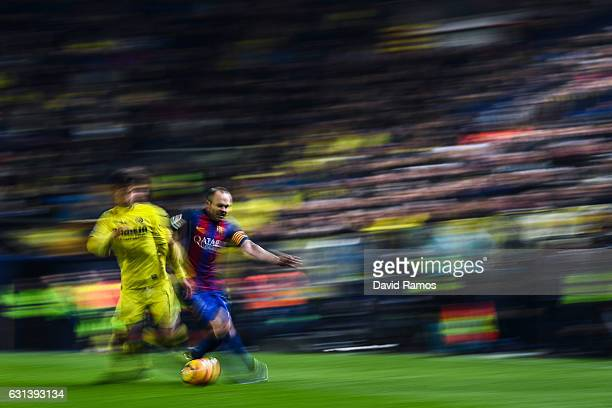 Andres Iniesta of FC Barcelona competes for the ball with Manu Trigueros of Villarreal CF during the La Liga match between Villarreal CF and FC...