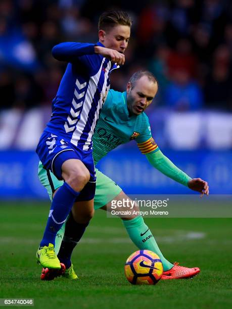 Andres Iniesta of FC Barcelona competes for the ball with Marcos Llorente of Deportivo Alaves during the La Liga match between Deportivo Alaves and...