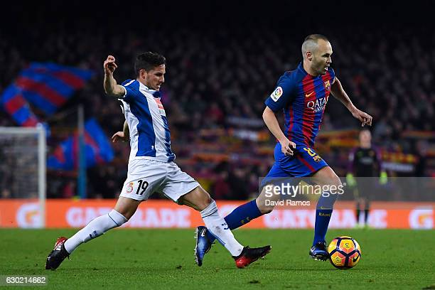Andres Iniesta of FC Barcelona competes for the ball with Pablo Piatti of RCD Espanyol during the La Liga match between FC Barcelona and RCD Espanyol...