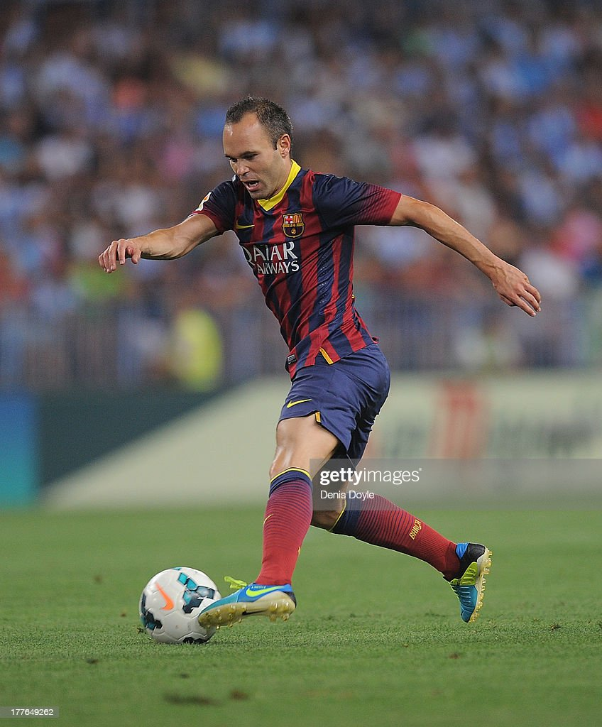 Andres Iniesta of FC Barcelona controls the ball during the La Liga match between Malaga CF and FC Barcelona at La Rosaleda Stadium on August 25, 2013 in Malaga, Spain.