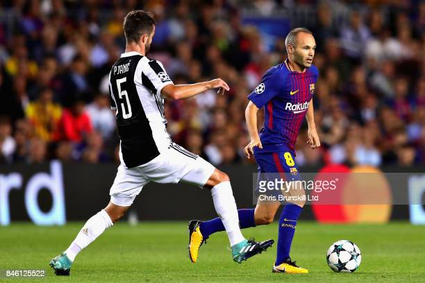 Andres Iniesta of FC Barcelona dribbles past Miralem Pjanic of Juventus during the UEFA Champions League group D match between FC Barcelona and...
