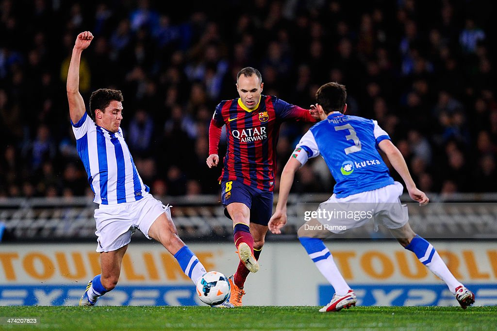 Andres Iniesta of FC Barcelona duels for the ball with Gorka Elustondo Urkola and Mikel Gonzalez Martinez of Real Sociedad during the La Liga match...