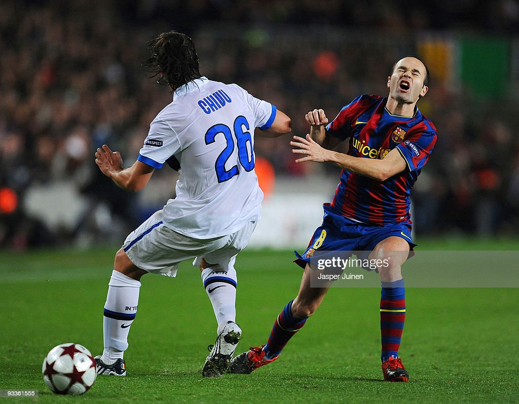 <a gi-track='captionPersonalityLinkClicked' href=/galleries/search?phrase=Andres+Iniesta&family=editorial&specificpeople=465707 ng-click='$event.stopPropagation()'>Andres Iniesta</a> (R) of FC Barcelona grimaces as he collides with <a gi-track='captionPersonalityLinkClicked' href=/galleries/search?phrase=Cristian+Chivu&family=editorial&specificpeople=675968 ng-click='$event.stopPropagation()'>Cristian Chivu</a> of Inter Milan during the UEFA Champions League group F match between FC Barcelona and Inter Milan at the Camp Nou Stadium on November 24, 2009 in Barcelona, Spain. Barcelona won the match 2-0.