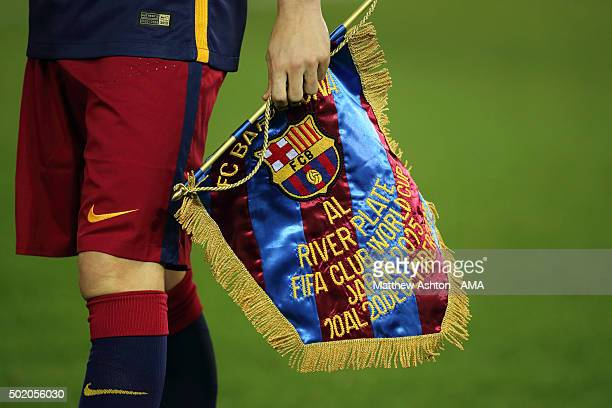 Andres Iniesta of FC Barcelona holds the commemorative pennant given to River Plate before the FIFA Club World Cup Final Match between FC Barcelona...