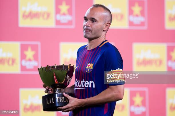 Andres Iniesta of FC Barcelona holds the trophy after the Joan Gamper Trophy match between FC Barcelona and Chapecoense at Camp Nou stadium on August...