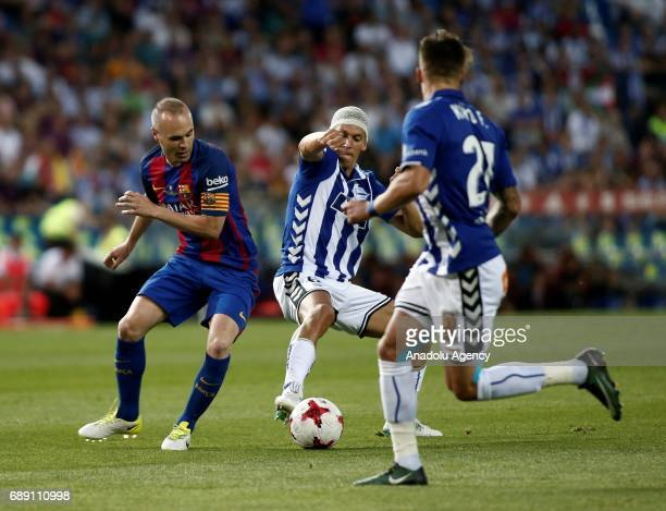 Andres Iniesta of FC Barcelona in action against Marcos Llorente of Deportivo Alaves during the Copa Del Rey Final between FC Barcelona and Deportivo...