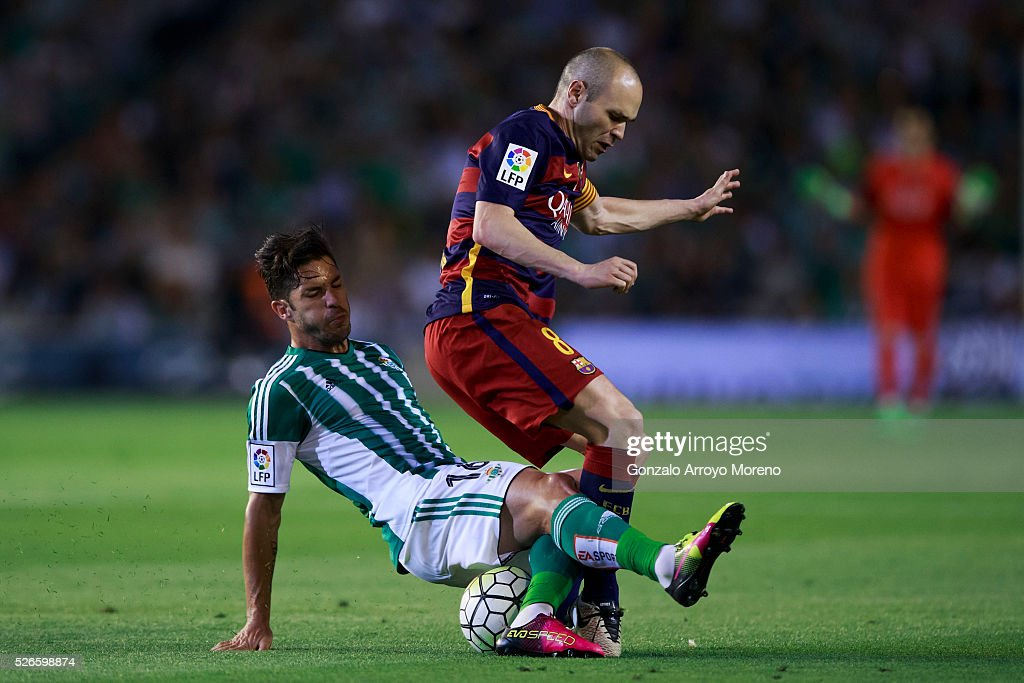 <a gi-track='captionPersonalityLinkClicked' href=/galleries/search?phrase=Andres+Iniesta&family=editorial&specificpeople=465707 ng-click='$event.stopPropagation()'>Andres Iniesta</a> (R) of FC Barcelona is tackled by Alvaro Cejudo (L) of Real Betis Balompie during the La Liga match between Real Betis Balompie and FC Barcelona at Estadio Benito Villamarin on April 30, 2016 in Seville, Spain.
