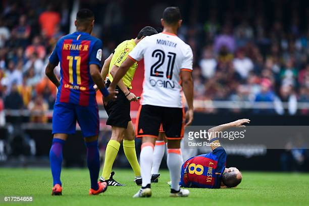 Andres Iniesta of FC Barcelona reacts injured on the pitch during the La Liga match between Valencia CF and FC Barcelona at Mestalla stadium on...
