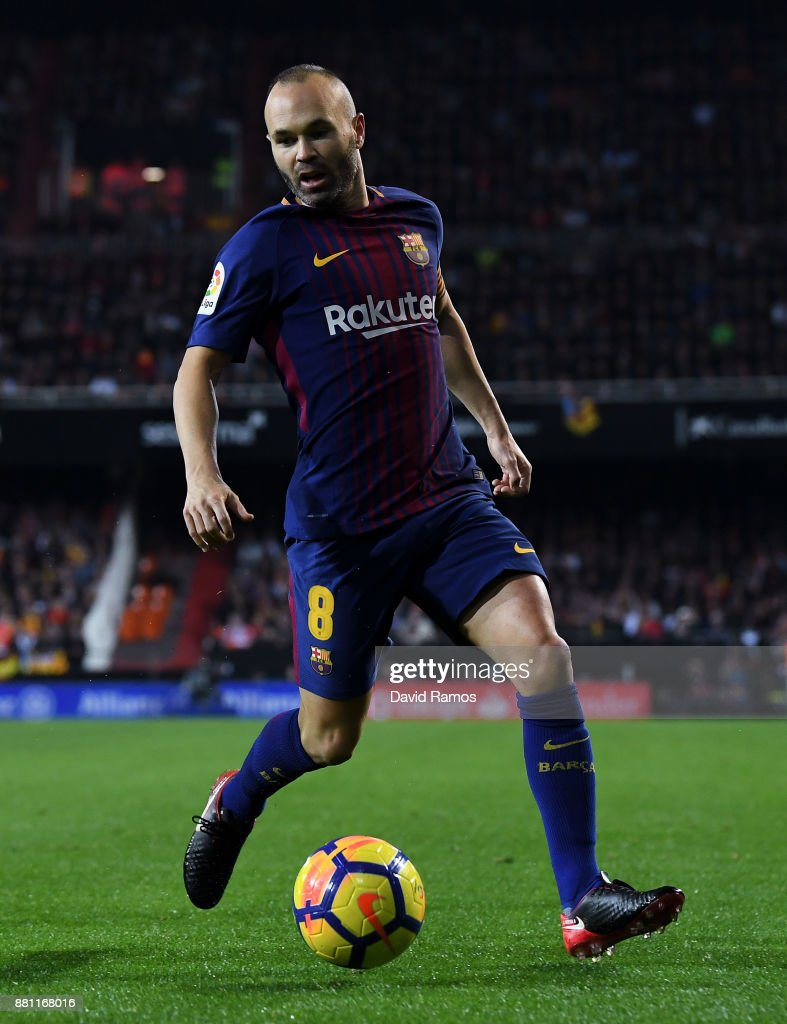 Andres Iniesta of FC Barcelona runs with the ball during the La Liga match between Valencia and Barcelona at Mestalla stadium on November 26, 2017 in Valencia, Spain.