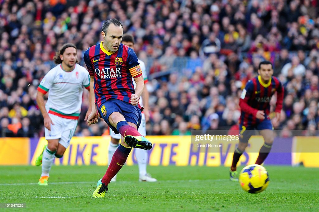 <a gi-track='captionPersonalityLinkClicked' href=/galleries/search?phrase=Andres+Iniesta&family=editorial&specificpeople=465707 ng-click='$event.stopPropagation()'>Andres Iniesta</a> of FC Barcelona scores the opening goal from the penalty spot during the La Liga match between FC Barcelona and Granda CF at Camp Nou on November 23, 2013 in Barcelona, Spain.