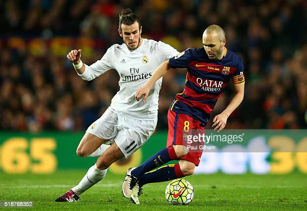 Andres Iniesta of FC Barcelona shields the ball from Gareth Bale of Real Madrid CF during the La Liga match between FC Barcelona and Real Madrid CF...
