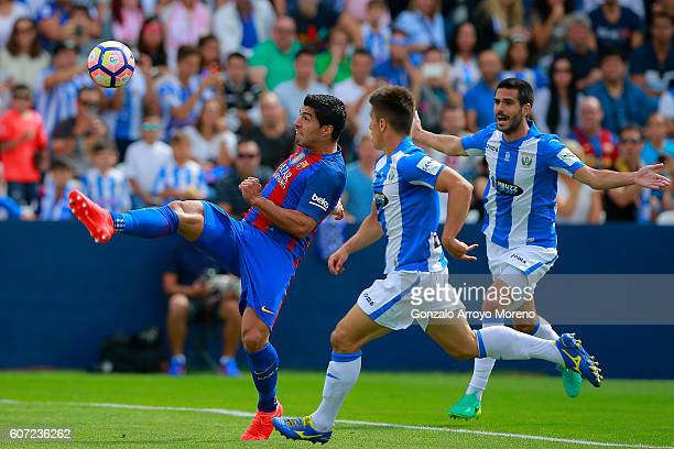 Andres Iniesta of FC Barcelona strikes the ball during the La Liga match between Deportivo Leganes and FC Barcelona at Estadio Municipal de Butarque...