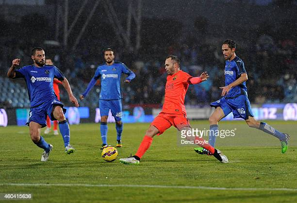 Andres Iniesta of FC Barcelona takes on Medhi Lacen of Getafe CF during the La Liga match between Getafe CF and FC Barcelona at the Alfonso Perez...