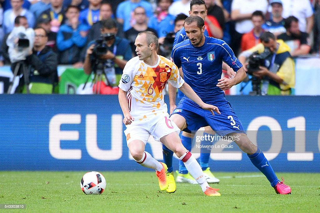 Andres Iniesta of Spain and Giorgio Chiellini of Italy during the European Championship match Round of 16 between Italy and Spain at Stade de France on June 27, 2016 in Paris, France.