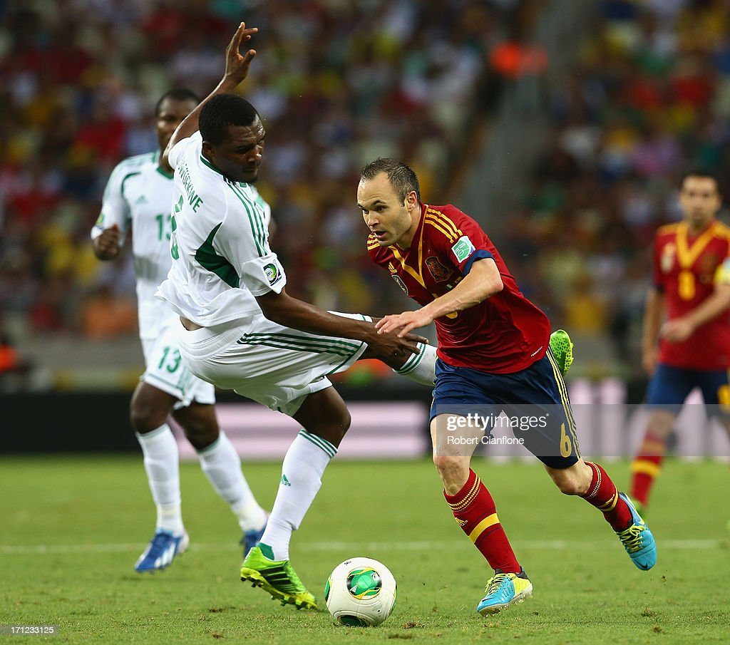 Andres Iniesta of Spain battles for the ball with Azubuike Egwuekwe of Nigeria during the FIFA Confederations Cup Brazil 2013 Group B match between Nigeria and Spain at Castelao on June 23, 2013 in Fortaleza, Brazil.