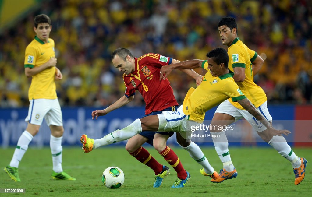 Andres Iniesta of Spain battles for the ball with Luiz Gustavo of Brazil during the FIFA Confederations Cup Brazil 2013 Final match between Brazil...