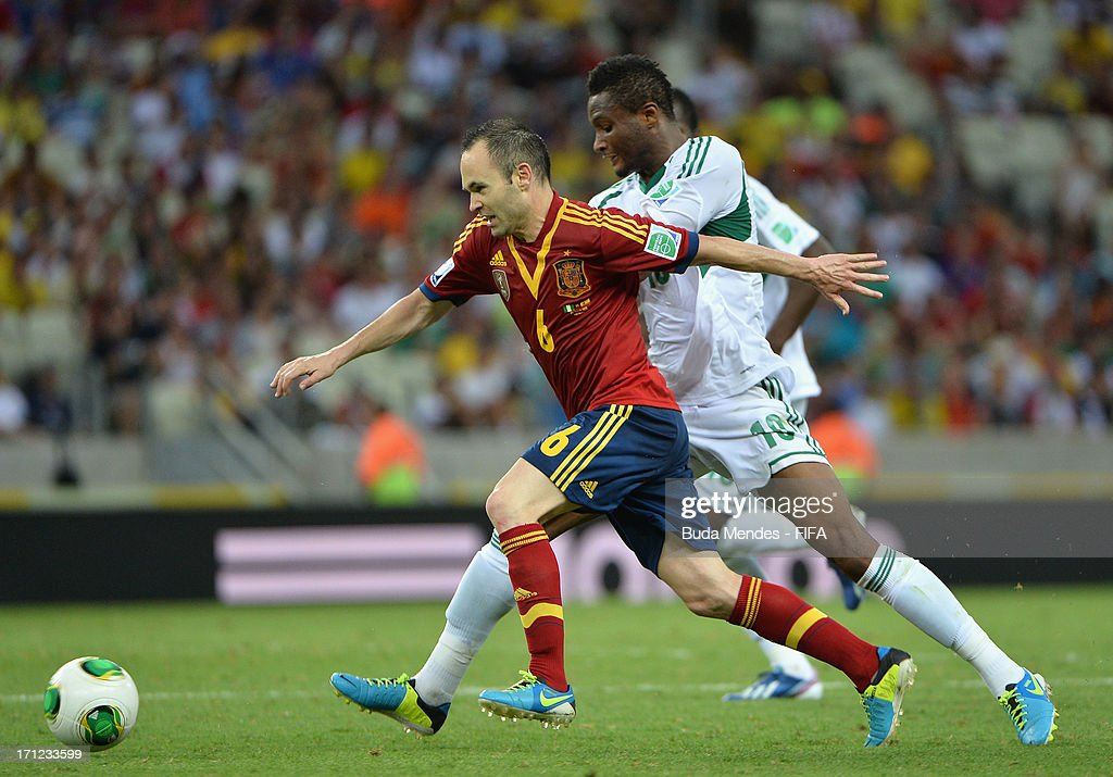 Andres Iniesta of Spain battles for the ball with Mikel John Obi of Nigeria during the FIFA Confederations Cup Brazil 2013 Group B match between Nigeria and Spain at Castelao on June 23, 2013 in Fortaleza, Brazil.