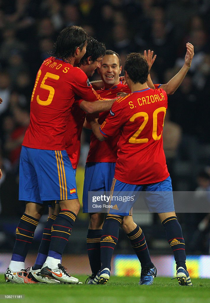 Andres Iniesta of Spain celebrates his goal during the UEFA EURO 2012 Group I qualifying match between Scotland and Spain at Hampden Park on October...