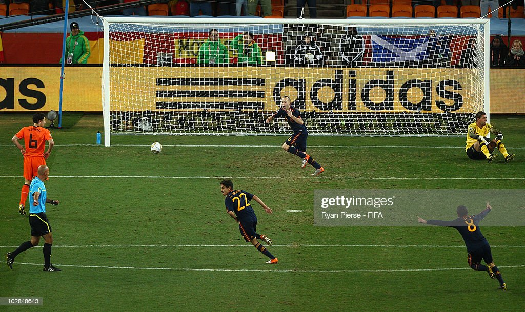 <a gi-track='captionPersonalityLinkClicked' href=/galleries/search?phrase=Andres+Iniesta&family=editorial&specificpeople=465707 ng-click='$event.stopPropagation()'>Andres Iniesta</a> of Spain celebrates scoring the winning goal during the 2010 FIFA World Cup South Africa Final match between Netherlands and Spain at Soccer City Stadium on July 11, 2010 in Johannesburg, South Africa.