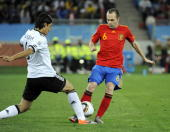 Andres Iniesta of Spain challenged by Sami Khedira of Germany during the 2010 FIFA World Cup South Africa Semi Final match between Germany and Spain...