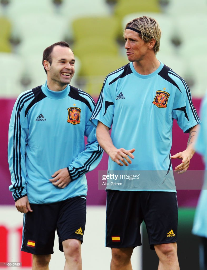 Andres Iniesta (L) of Spain chats with Fernando Torres during a UEFA EURO 2012 training session ahead of their Group C match against Italy at the Municipal Stadium on June 9, 2012 in Gdansk, Poland.