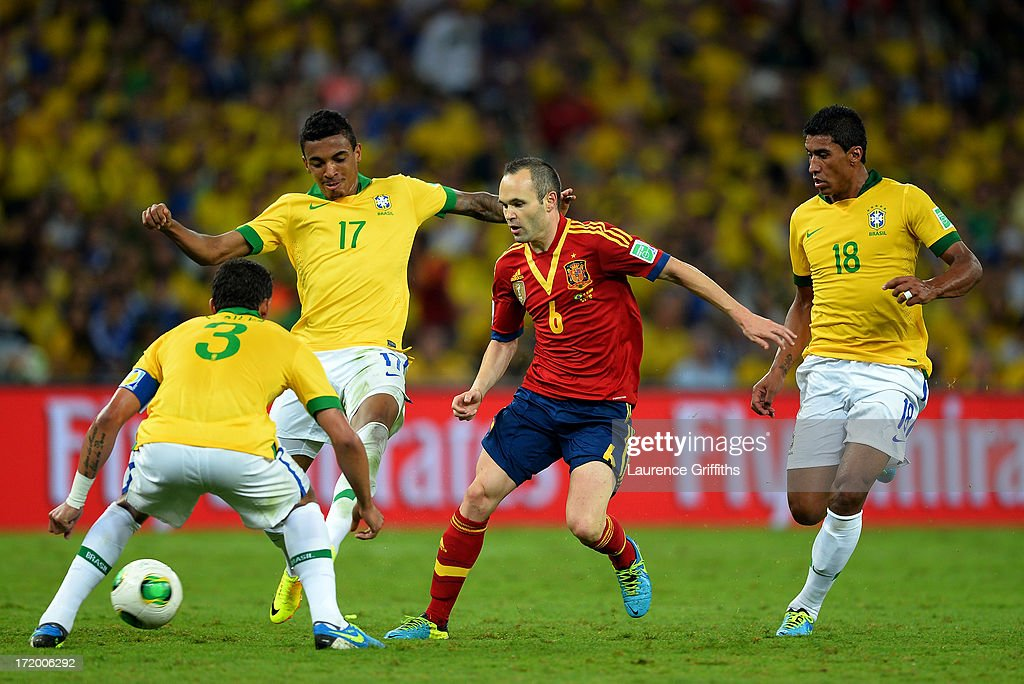 Andres Iniesta of Spain competes with Thiago Silva Luiz Gustavo and Paulinho of Brazil during the FIFA Confederations Cup Brazil 2013 Final match...