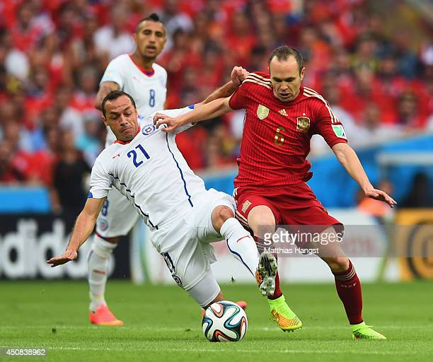 Andres Iniesta of Spain holds off Marcelo Diaz of Chile during the 2014 FIFA World Cup Brazil Group B match between Spain and Chile at Maracana on...