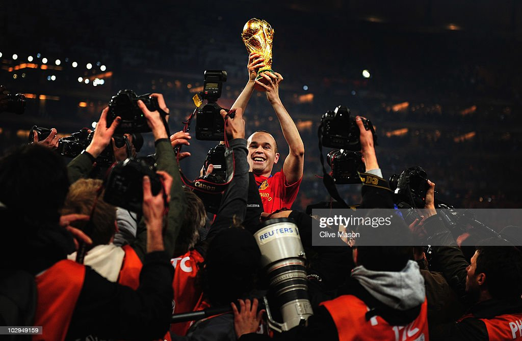 <a gi-track='captionPersonalityLinkClicked' href=/galleries/search?phrase=Andres+Iniesta&family=editorial&specificpeople=465707 ng-click='$event.stopPropagation()'>Andres Iniesta</a> of Spain holds the World Cup trophy aloft after the 2010 FIFA World Cup South Africa Final match between Netherlands and Spain at Soccer City Stadium on July 11, 2010 in Johannesburg, South Africa.