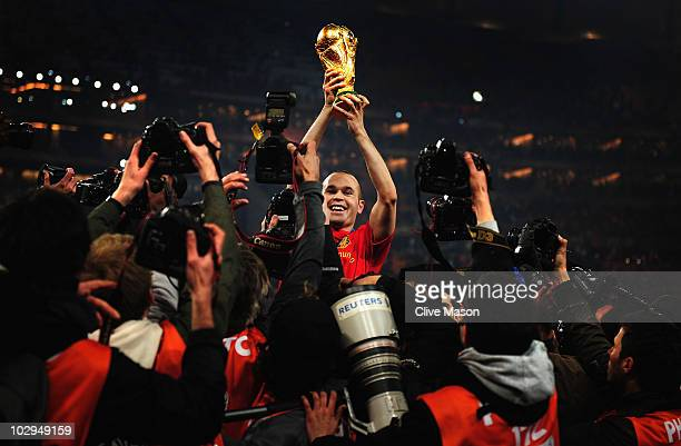 Andres Iniesta of Spain holds the World Cup trophy aloft after the 2010 FIFA World Cup South Africa Final match between Netherlands and Spain at...