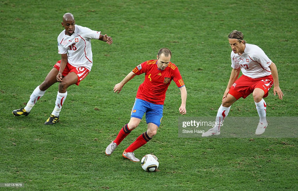 <a gi-track='captionPersonalityLinkClicked' href=/galleries/search?phrase=Andres+Iniesta&family=editorial&specificpeople=465707 ng-click='$event.stopPropagation()'>Andres Iniesta</a> of Spain is closed down by <a gi-track='captionPersonalityLinkClicked' href=/galleries/search?phrase=Gelson+Fernandes&family=editorial&specificpeople=2971817 ng-click='$event.stopPropagation()'>Gelson Fernandes</a> (L) and <a gi-track='captionPersonalityLinkClicked' href=/galleries/search?phrase=Reto+Ziegler&family=editorial&specificpeople=226720 ng-click='$event.stopPropagation()'>Reto Ziegler</a> of Switzerland during the 2010 FIFA World Cup South Africa Group H match between Spain and Switzerland at Durban Stadium on June 16, 2010 in Durban, South Africa.