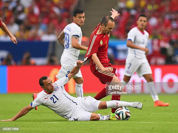 Andres Iniesta of Spain is tackled by Marcelo Diaz of Chile during the 2014 FIFA World Cup Brazil Group B match between Spain and Chile at Maracana...