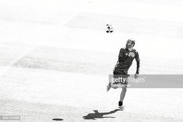 Andres Iniesta of Spain juggles the ball during a training session ahead of their UEFA Euro 2016 round of 16 match against Italy at Complexe Sportif...