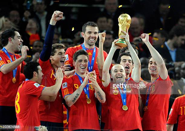 Andres Iniesta of Spain lifts the trophy and celebrates with teammates after the 2010 FIFA World Cup Final between the Netherlands and Spain on July...