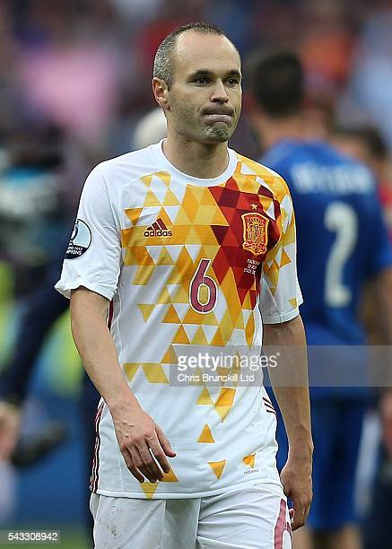 Andres Iniesta of Spain looks dejected at fulltime following the UEFA Euro 2016 Round of 16 match between Italy and Spain at Stade de France on June...