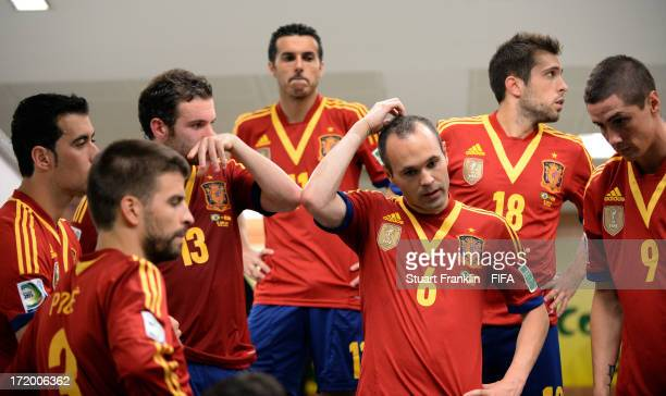 Andres Iniesta of Spain looks on with his teammates at halftime during the FIFA Confederations Cup Brazil 2013 Final match between Brazil and Spain...