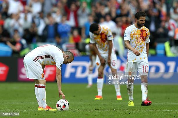 Andres Iniesta of Spain places the ball down to restart play following Italy's second goal during the UEFA Euro 2016 Round of 16 match between Italy...