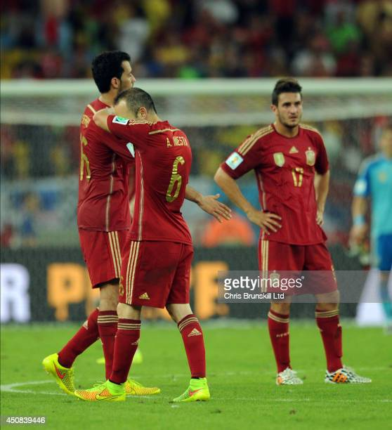 Andres Iniesta of Spain reacts at fulltime following the 2014 FIFA World Cup Brazil Group B match between Spain and Chile at Maracana Stadium on June...