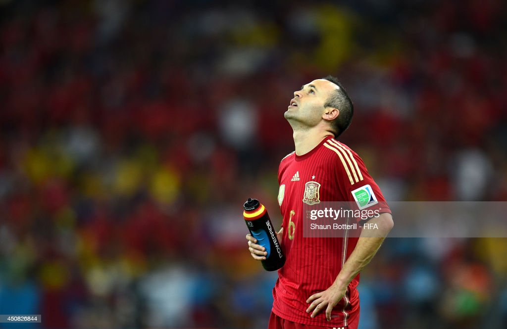 <a gi-track='captionPersonalityLinkClicked' href=/galleries/search?phrase=Andres+Iniesta&family=editorial&specificpeople=465707 ng-click='$event.stopPropagation()'>Andres Iniesta</a> of Spain reacts during the 2014 FIFA World Cup Brazil Group B match between Spain and Chile at Estadio Maracana on June 18, 2014 in Rio de Janeiro, Brazil.