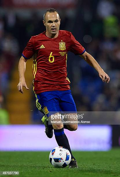 Andres Iniesta of Spain runs with the ball during the international friendly match between Spain and England at Jose Rico Perez Stadium on November...
