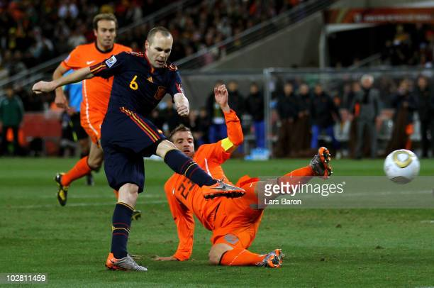 Andres Iniesta of Spain scores his side's first goal during the 2010 FIFA World Cup South Africa Final match between Netherlands and Spain at Soccer...