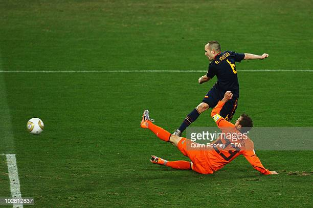 Andres Iniesta of Spain scores the winning goal beyond the challenge of Rafael Van der Vaart of the Netherlands during the 2010 FIFA World Cup South...