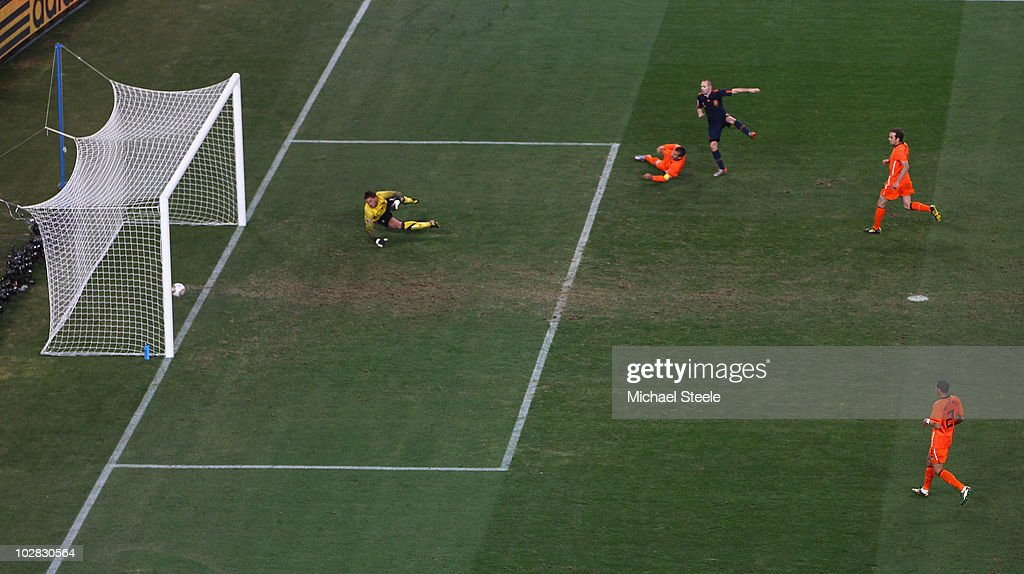 <a gi-track='captionPersonalityLinkClicked' href=/galleries/search?phrase=Andres+Iniesta&family=editorial&specificpeople=465707 ng-click='$event.stopPropagation()'>Andres Iniesta</a> of Spain scores the winning goal during the 2010 FIFA World Cup South Africa Final match between Netherlands and Spain at Soccer City Stadium on July 11, 2010 in Johannesburg, South Africa.