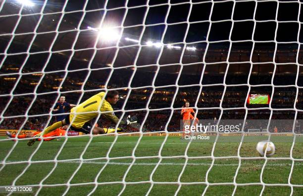 Andres Iniesta of Spain scores the winning goal past Maarten Stekelenburg of the Netherlands during the 2010 FIFA World Cup South Africa Final match...