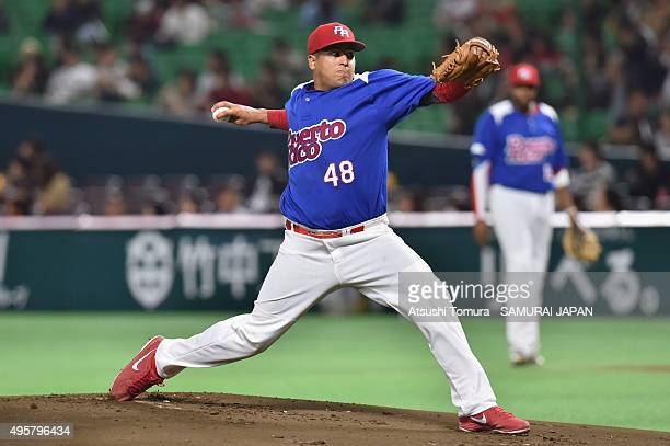 Andres Manuel Santiago Rondon of Puerto Rico pitches in the top half of the first inning during the sendoff friendly match for WBSC Premier 12...