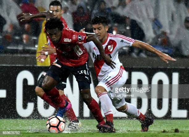 Andres Mosquera of Deportivo Independiente Medellin vies for the ball with Sebastian Driussi of River Plate during a group stage match between...