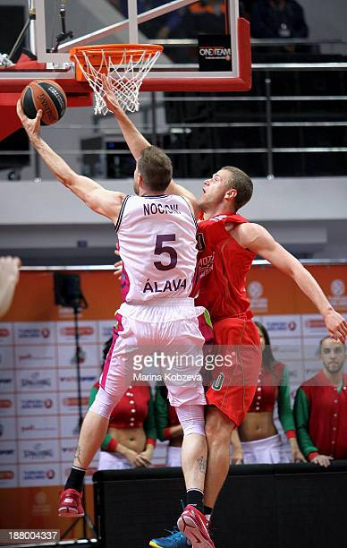 Andres Nocioni #5 of Laboral Kutxa Vitoria competes with Andrey Zubkov #20 of Lokomotiv Kuban Krasnodar during the 20132014 Turkish Airlines...