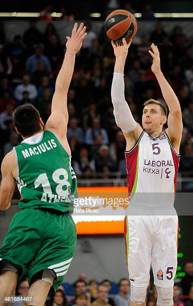 Andres Nocioni #5 of Laboral Kutxa Vitoria competes with Jonas Maciulis #18 of Panathinaikos Athens during the 20132014 Turkish Airlines Euroleague...