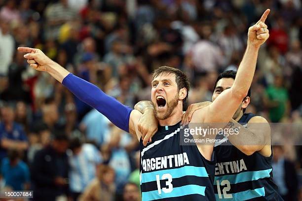 Andres Nocioni and Martin Leiva of Argentina celebrate Argentina's 8277 victory against Brazil during the Men's Basketball quaterfinal game on Day 12...